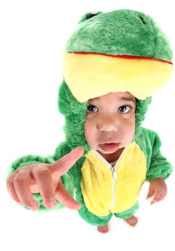 Toddler in dinosaur costume